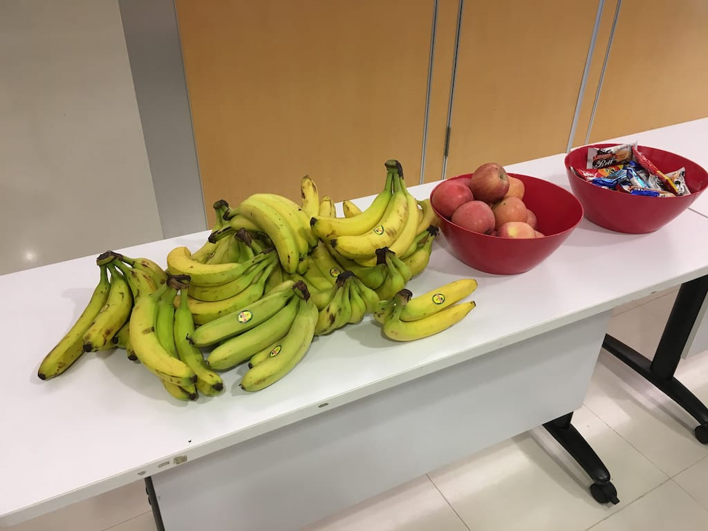 Banana, apple and snacks on a table at Webconf.Asia