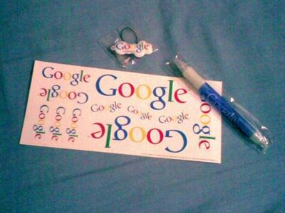 Google goodies, including a pen, stickers and some badge thing