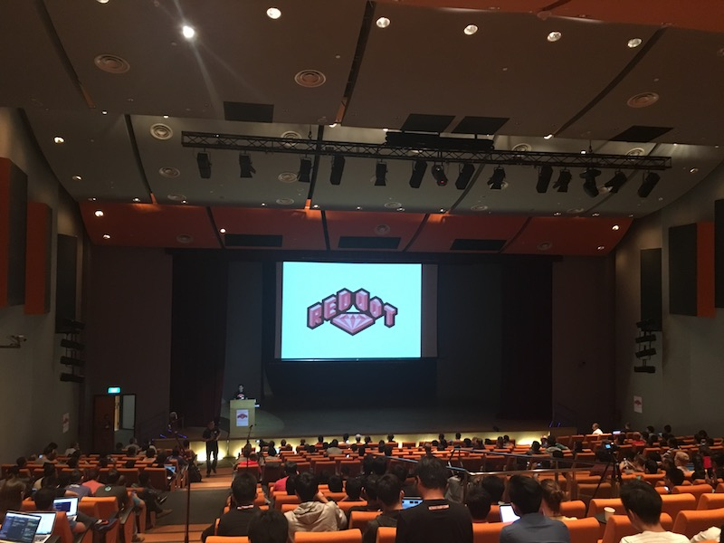 RedDotRubyConf 2016 logo on a slide shown on the conference stage