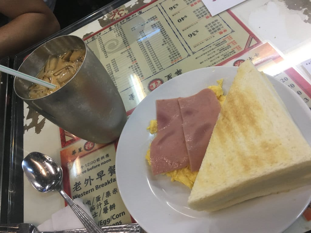"Scrambled egg with ham and toast, and ""lai cha"", in Hong Kong"
