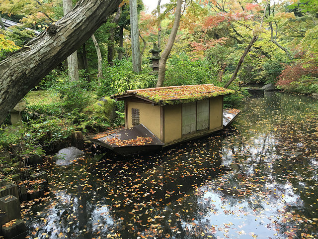Boat in a pond in a garden at Nezu Museum in Tokyo